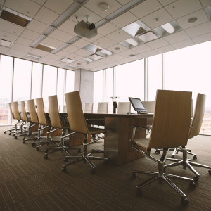 An image showing office desks in a meeting room.